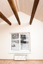Wooden cross beam in home interior on the ceiling Royalty Free Stock Photography