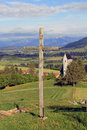 Wooden cross everywhere in bavaria there are big crosses this stands on a mountain about the church of mittelberg Stock Image