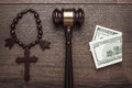 Wooden cross gavel and money on brown table background concept Royalty Free Stock Photos