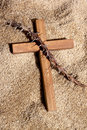 Wooden Cross and Thorns on Sand Background Stock Photography