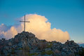 Wooden cross top mountain sunset Stock Images