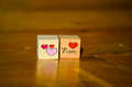 Wooden cubes with hand written inscription from heart with red and pink heart