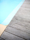 Wooden deck of blue swimming pool detail and Stock Photography