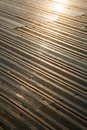 A wooden deck completely soaked wet depicting the late afternoon yellow sun reflected as blown highlights dear inspector the over Royalty Free Stock Photo
