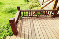 Wooden deck corner of with balustrade in garden Royalty Free Stock Images