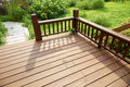 Wooden deck corner of empty with balustrade in garden Stock Photography