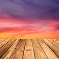 Wooden deck floor over beautiful sunset background. Royalty Free Stock Photo