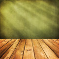 Wooden deck floor over green grunge background ready for product display montage Royalty Free Stock Images