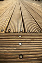 A wooden deck floor in the sunlight diminishing pespective very wide angle Royalty Free Stock Photos