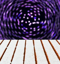 Wooden deck snow motion blur lights background Stock Image