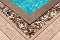 Wooden deck and stone at the corner of swimming pool Royalty Free Stock Photo