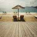 Wooden deck terrace over sea beach and sky. Summer vacation background. Royalty Free Stock Photo