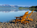 Wooden deckchairs overlooking scenic Lake Laberge Royalty Free Stock Photo