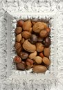 Wooden decorated classic white frame, varied nuts Royalty Free Stock Photography