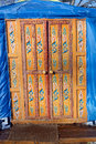 Wooden decorated orange door kazakh yurt Royalty Free Stock Photo