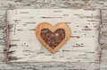 Wooden decorative heart on the birch bark Royalty Free Stock Photo