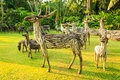 Wooden deer statue on the green park Stock Images