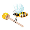 Wooden dipper with honey carried by bee Stock Image