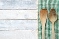 Wooden dipper kitchenware and on a table cloth on a white wooden table Royalty Free Stock Photo