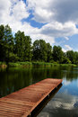 Wooden dock / pier on a lake Stock Photo