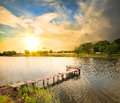 Wooden dock pier on a lake in the evening Royalty Free Stock Photography