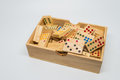 Wooden dominos in wooden box on white background with selective focus Royalty Free Stock Photo