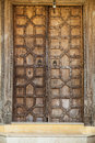 Wooden door with ancient floral patten. Wood carving technic. Royalty Free Stock Photo