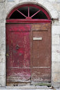 Wooden door with arch at derelict house Royalty Free Stock Images