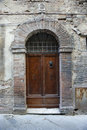 Wooden door with brick archway. Royalty Free Stock Image