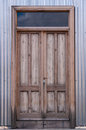 Wooden door in corrugated metal ushuaia Stock Images
