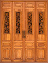 Wooden door decorated with floral wood carvings object Stock Photos