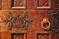 Wooden door with golden handle closeup of old ornate a gold in alba italy Royalty Free Stock Photos