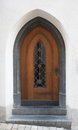 Wooden door with gothic ogive arch Royalty Free Stock Photo