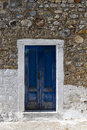 Wooden door in greece blue old stone mediterranean building Royalty Free Stock Photos