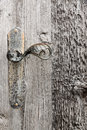 Wooden door with iron handle a detail of a and withered wood Stock Photos