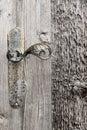 Wooden door with iron handle. Royalty Free Stock Photo