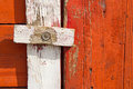 Wooden door latch homemade wood on weathered wood Stock Photo