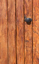 Wooden door with lock close up photo Royalty Free Stock Images