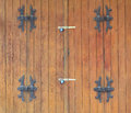 Wooden door locked by padlocks Royalty Free Stock Photo