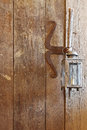 Wooden door made of barn wood with rustic vintage candle lamps Royalty Free Stock Photo