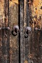 Wooden door with metal padlocks Royalty Free Stock Photo