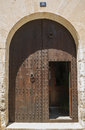 Wooden door of old stone house spain Stock Photos