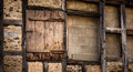 Wooden door on old wall german house with brick Royalty Free Stock Image