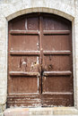 The wooden door on the old walls Royalty Free Stock Photo
