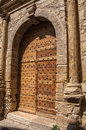 Wooden door and stone arch in ancient Châteaudouble church. Royalty Free Stock Photo