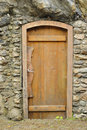 Wooden door in a stone wall Royalty Free Stock Images