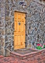 Wooden door on stone wall see my other works in portfolio Stock Images