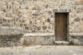 Wooden door and stone wall spanish colonial style in antigua guatemala Stock Photos