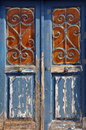 Wooden door vintage metal frame old with pattern and chipped paint texture Royalty Free Stock Image