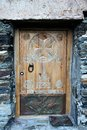 Wooden door vintage with ornament on stone wall background Stock Image